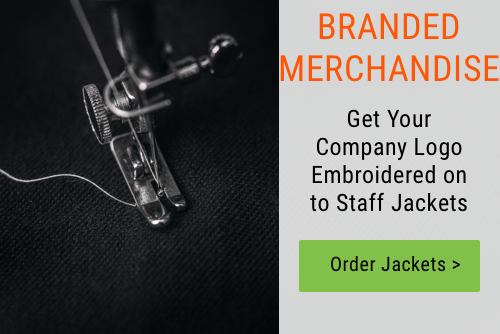 Banner promoting embroidered jackets featuring sewing machine