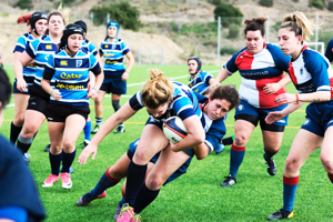Women at university playing a game of rugby