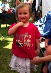 "A young lady posing with her ""Dubs at the Castle"" 2012 t-shirt"