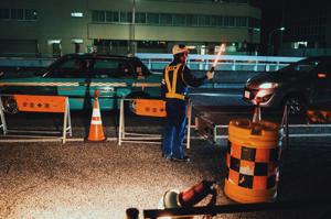 Roadworkers wearing work safety gear