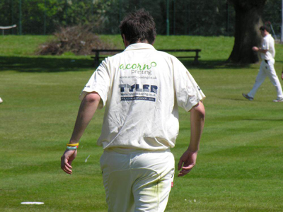 Cricket player wearing acorn printed shirt